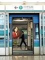 Train doors open at the Airport Station (Hong Kong).jpg