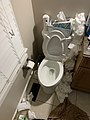 Trash cluttered bathroom with toilet.jpg