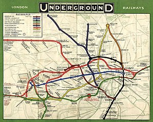 "A map titled ""London Underground Railways"" showing each of the underground railway lines in a different colour with stations marked as blobs. Faint background detail shows the River Thames, roads and non-underground lines."