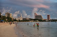 Beach, with modern buildings in the backgroundTumon Beach on Guam