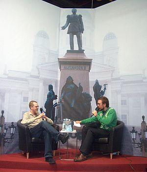 Finnish writer Tuomas Kyrö (on the left) was i...