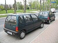 Two Daewoo Tico - rear