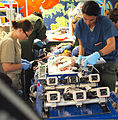 U.S. Air Force 1st Lt. Elizabeth Spataro, left, pediatric intensive care nurse; Capt. Gennifer Bradshaw, foreground right, neonatal intensive care nurse and extracorporeal membrane oxygenation (ECMO) specialist 120809-F-UR000-375.jpg