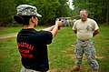 U.S. Army Pfc. Samuel Lazar, right, with Headquarters and Headquarters Company, 105th Military Police Battalion, North Carolina Army National Guard, is exposed to oleoresin capsicum (OC) spray by Sgt. Jessica 130501-Z-AY498-021.jpg