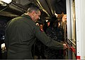 U.S. Navy Capt. Daniel Grieco, the commanding officer of the aircraft carrier USS Theodore Roosevelt (CVN 71), cuts a ribbon during the grand opening of the Rough Rider Trading Post store aboard the ship 131111-N-ED185-012.jpg