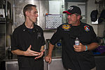 "U.S. Navy Culinary Specialist 2nd Class Adam Johnson speaks with celebrity chef John Conley during a Navy Entertainment ""Mess Lords"" event aboard the aircraft carrier USS Harry S. Truman (CVN 75) in the Gulf 130829-N-LH273-005.jpg"