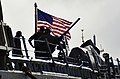 U.S. Sailors aboard the guided missile destroyer USS Russell (DDG 59) prepare to leave Joint Base Pearl Harbor-Hickam, Hawaii 130103-N-RI884-015.jpg