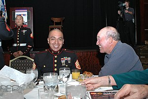 Joe Santos - Staff Sgt. Nicolas Perez, a recruiter with Recruiting Station Los Angeles, laughs with Joe Santos