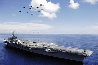 Carrier air wing - Aircraft from Carrier Air Wing Two fly in formation above the USS Abraham Lincoln.