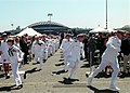 """US Navy 020622-N-8252B-010 Sailors stationed aboard USS Shoup run to """"man the rails"""" during the commissioning ceremony.jpg"""