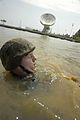 US Navy 040518-N-9693M-007 A Midshipman washes sand and mud off in the Chesapeake during Sea Trials.jpg
