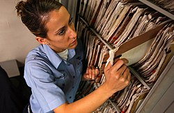 US Navy 041019-N-5821P-019 Airman Lauren Thurgood of Las Vegas, Nev., pulls patient medical records in the inpatient ward aboard the conventionally powered aircraft carrier USS Kitty Hawk.jpg