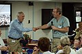 US Navy 050214-N-8796S-035 CEO of the non-governmental organization Project Hope, Dr. John Howe, left, and President, Massachusetts General Hospital, Dr. Peter Slavin, shake hands during an address to the crew aboard the hospit.jpg