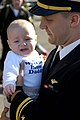 US Navy 050301-N-6074Y-056 A Naval Aviator, assigned to Carrier Air Wing Two (CVW-2) greets his newborn child for the first time after returning from a deployment to the Western Pacific Ocean.jpg