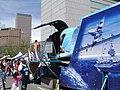 US Navy 050508-N-5324D-005 Cinco De Mayo festival participants exit the Navy's premier Blue Angels F-18 flight simulator.jpg