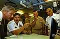 US Navy 050805-F-4883S-006 Master Chief Petty Officer of the Navy (MCPON) Terry D. Scott, second from the left, discusses a scene from a U.S. Navy capabilities video.jpg