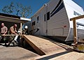 US Navy 051026-N-9583M-005 U.S. Navy Instructors assigned to Naval Construction Training Center (NCTC) Gulfport, build a ramp that will provide easy entry into a travel trailer for a retired Navy Seabee.jpg