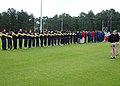 US Navy 070117-N-4049C-039 Soccer players competing in the Armed Forces Soccer Championship bow their heads in prayer during the tournaments opening ceremony.jpg