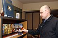 US Navy 070223-N-2143T-002 Storekeeper 2nd Class Mark Mckibbin assigned to fleet ballistic missile submarine USS Kentucky (SSBN 737) browses through books during his leisure time at the resource center.jpg