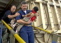 US Navy 070701-N-6278K-136 Lt. Cmdr. Karl Kish, a Navy chaplain, carries a patient off Military Sealift Command hospital ship USNS Comfort (T-AH 20) into a boat for a return home to Guatemala.jpg
