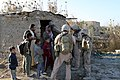 US Navy 071229-M-4746J-004 Marines assigned to I Co., 3rd Battalion, 3rd Marine Regiment speak with a local shopkeeper in Zaidon, Iraq during a mission to gather information, patrol area neighborhoods and interact with the resi.jpg