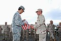 US Navy 080528-A-6489K-051 embers of the Coast Guard's Port Security Unit 313 presents Army Brig. Gen. Gregory Zanetti, deputy commander, Joint Task Force Guantanamo, a Coast Guard flag to keep in remembrance of the unit.jpg