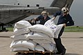 US Navy 080909-N-3595W-244 U.S. Navy personnel assigned to the amphibious assault ship USS Kearsarge (LHD 3) unload sacks of food for delivery to citizens affected by the recent hurricanes that have stuck Haiti.jpg