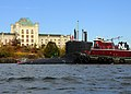 US Navy 081019-N-6553L-044 The Virginia-class attack submarine Pre-commissioning Unit New Hampshire (SSN 778) passes in front of the historic former naval prison as she makes her way up the Piscataqua River.jpg