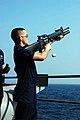 US Navy 081128-N-7239B-003 Gunner's Mate 3rd Class Edwin Finn ejects the spent shell from a M203 barrel.jpg