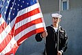 US Navy 090125-N-6185C-002 Engineman 3rd Class Stewart tightens the national ensign in his grip before morning colors.jpg