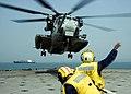US Navy 090212-N-1251W-113 Landing Signalmen launch a CH-53E Sea Stallion helicopter.jpg