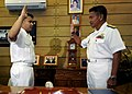 US Navy 090219-N-3830J-100 Culinary Specialist 1st Class Paul Arboleda, assignedto the amphibious command ship USS Blue Ridge (LCC 19), reenlists as Vice Adm. Ferdinand S. Golez, flag officer in command of the Philippine Navy,.jpg