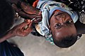 US Navy 090310-N-0506A-059 A World Health Organization (WHO) staff member vaccinates a baby during a Combined Joint Task Force-Horn of Africa medical civil action project.jpg