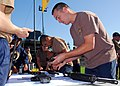 US Navy 090313-N-9698C-077 Construction Electrician 1st Class Spence Zook, assigned to Naval Facilities Engineering Command Pacific Seabee Self-help, assembles an M-16s rifle during a Seabee Olympics competition at Naval Statio.jpg