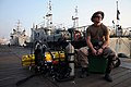 US Navy 091116-N-4154B-002 Navy Diver 2nd Class Zachery Dojaquez waits on the Iraqi Navy pier before a day of diving operations.jpg