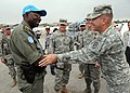 US Navy 100306-N-5961C-009 Lt. Gen. Ken Keen, commanding general of Joint Task Force Haiti, greets one of the U.N. peacekeepers working at internally displaced person's Camp Ancien.jpg