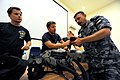 US Navy 100321-N-0553R-095 Explosive Ordnance Disposal Technician 1st Class Josh Burns answers questions about specific pre-dive considerations.jpg