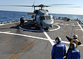 US Navy 100421-N-1559J-015 Boatswain's Mate 1st Class Chuyi Chang signals to the pilot of an SH-60B Sea Hawk helicopter, from Helicopter Anti-submarine Squadron (HS) 46, aboard the guided-missile destroyer USS Laboon (DDG 58) d.jpg