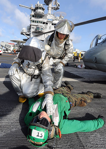 File:US Navy 100813-N-1287L-037 Members of the crash and salvage team check a Sailor for injuries during a mass casualty exercise on the flight deck of USS Enterprise (CVN 65).jpg