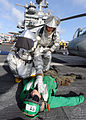 US Navy 100813-N-1287L-037 Members of the crash and salvage team check a Sailor for injuries during a mass casualty exercise on the flight deck of USS Enterprise (CVN 65).jpg