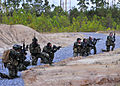 US Navy 101025-N-4044H-128 Navy SEALs conduct immediate action drills at the John C. Stennis Space Center.jpg