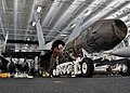 US Navy 110221-N-SG869-035 Cpl. Alantheus Thompson inspects an engine for an F-A-18C Hornet for proper insulation in the hangar bay aboard USS Rona.jpg