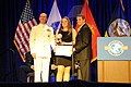 US Navy 110407-N-4930E-523 Vice Chief of Naval Operations Adm. Jonathan W. Greenert presents this year's Navy Military Child of the Year Award to M.jpg