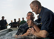US Navy 110508-N-DR144-024 Lt. Jeffrey Ross, a chaplain aboard the Nimitz-class aircraft carrier USS Carl Vinson (CVN 70), baptizes Aviation Boatsw