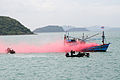 US Navy 110515-N-WL717-045 Two Royal Thai Navy assault boats simulate firing upon a fishing boat using red smoke to indicate a hit, while demonstra.jpg