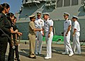 US Navy 110628-N-NJ145-282 Cmdr. Scott Erb, commanding officer of the guided-missile destroyer USS Chung-Hoon (DDG-93) is met at the pier.jpg