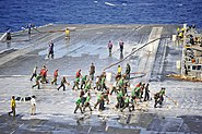 US Navy 110824-N-BR887-045 Sailors wash down the flight deck