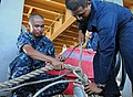 US Navy 110927-N-MW330-480 Boatswain's Mate 2nd Class Dennis Castro, left, and Boatswain's Mate Seaman Ulyses Morero splice a line aboard the forwa.jpg