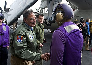 US Navy 120121-N-FI736-118 Secretary of Defense (SECDEF) Leon Panetta greets Sailors upon arrival aboard the aircraft carrier USS Enterprise (CVN 6.jpg