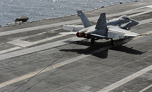 US Navy 120216-N-VO377-432 An F-A-18C Hornet assigned to the Blue Blasters of Strike Fighter Squadron (VFA) 34 traps the arresting wire on the flig.jpg